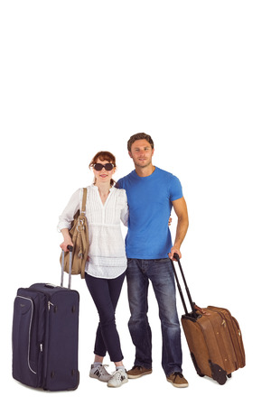 Happy couple going on holiday on white background photo