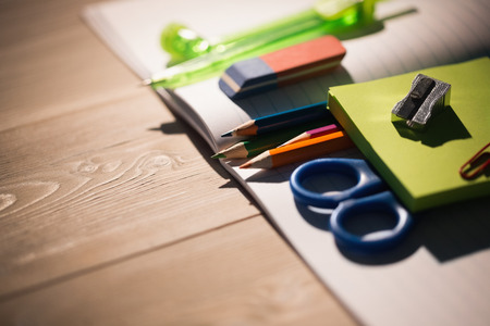 Students table with school supplies on it Stock Photo