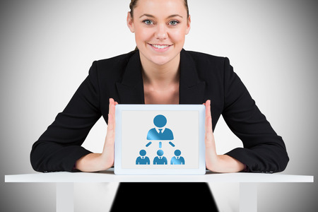 organisational: Businesswoman showing tablet pc against white background with vignette