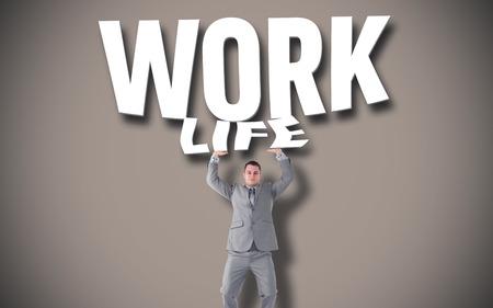 upward struggle: Portrait of a businessman pushing against grey background with vignette Stock Photo