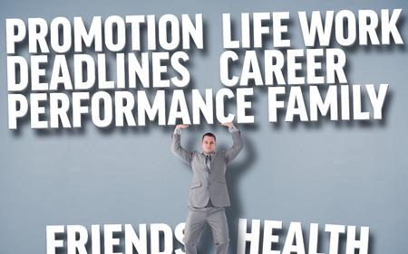 upward struggle: Portrait of a businessman pushing against grey background with text Stock Photo