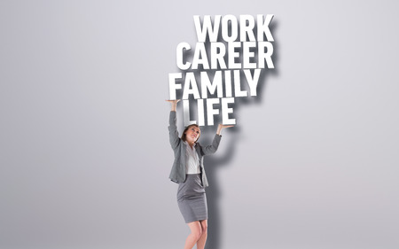 Businesswoman pushing up with hands against grey background with text photo