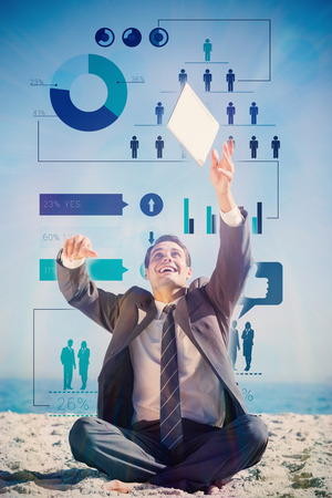out of context: Victorious young businessman juggling with his tablet with business infographic Stock Photo