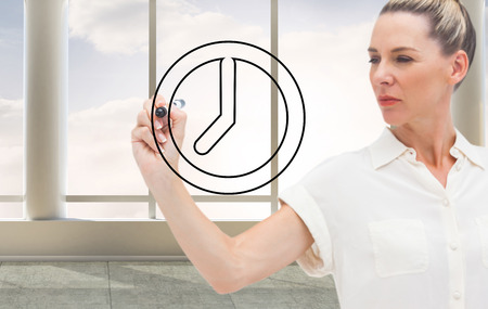 Composite image of business person drawing a black clock Stock Photo