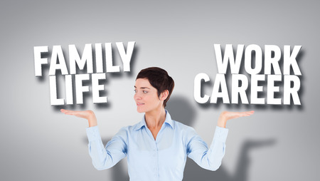 work life balance: Composite image of smiling businesswoman presenting grey background with text Stock Photo