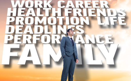 unsmiling: Unsmiling businessman standing against beautiful orange and blue sky with text