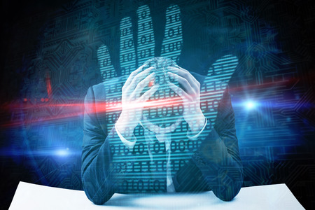 bowed head: Businessman with head in hands against digital security hand print scan