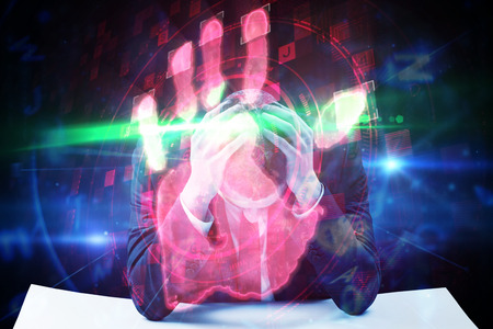 bowed head: Businessman with head in hands against red technology hand print design