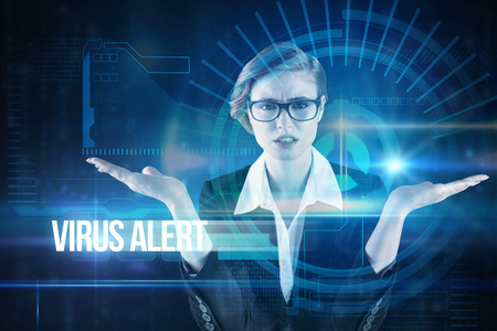 The word virus alert and businesswoman holding hand out in presentation against blue technology interface with dial photo