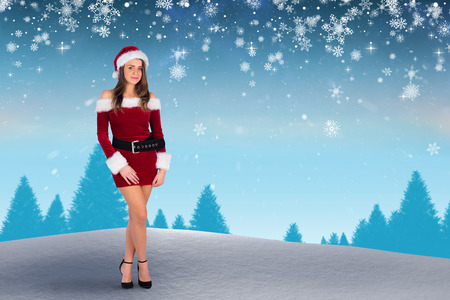 santa girl smiling at camera against fir tree forest photo