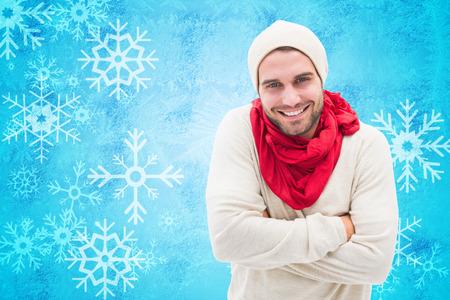 Handsome hipster against blue snow flake pattern design photo