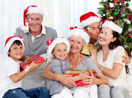 Smiling family at Christmas against snow falling photo