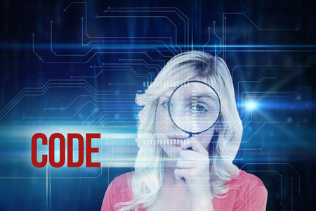 fair haired: The word code and fair haired woman looking through a magnifying glass against blue technology interface with circuit board
