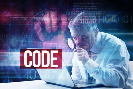The word code and mature businessman examining with magnifying glass against pink technology hand print interface design photo