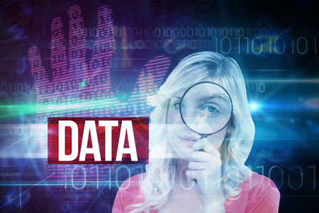 The word data and fair-haired woman looking through a magnifying glass against pink technology hand print binary design photo