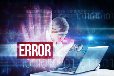 The word error and redhead businesswoman using her laptop against red technology hand print design photo