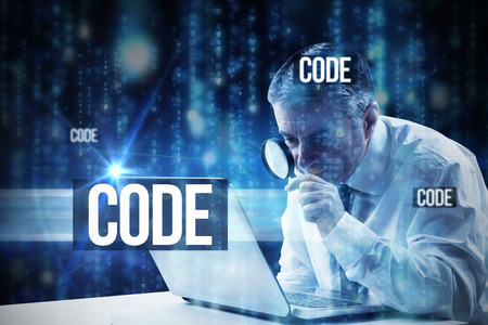 The word code and mature businessman examining with magnifying glass against lines of blue blurred letters falling photo