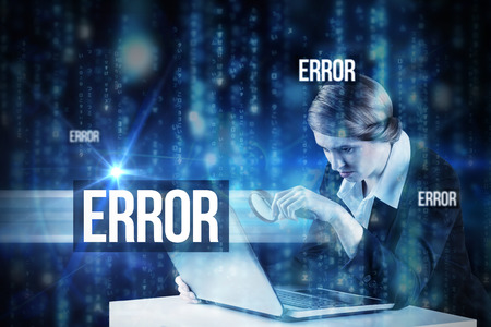 The word error and redhead businesswoman using her laptop against lines of blue blurred letters falling photo