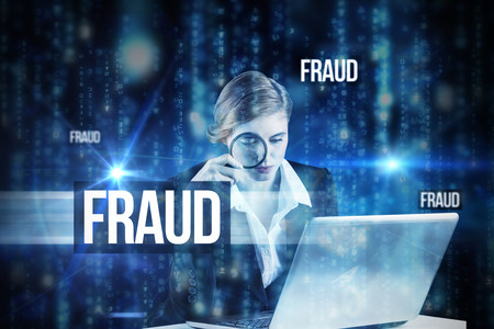 The word fraud and redhead businesswoman using her laptop against lines of blue blurred letters falling photo