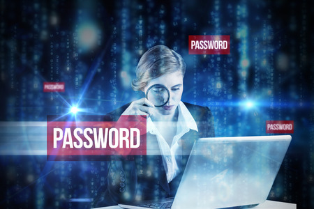The word password and redhead businesswoman using her laptop against lines of blue blurred letters falling photo