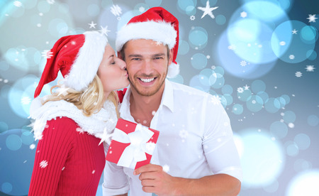 Young festive couple against light glowing dots design pattern photo