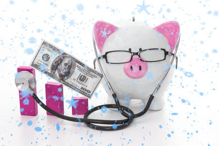 Snow falling against pink and white piggy bank wearing glasses and stethoscope photo