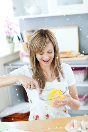 gratified: Delighted woman preparing eggs in the kitchen  with twinkling stars
