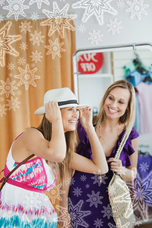 choosing clothes: Smiling women choosing clothes together with snowflakes on silver