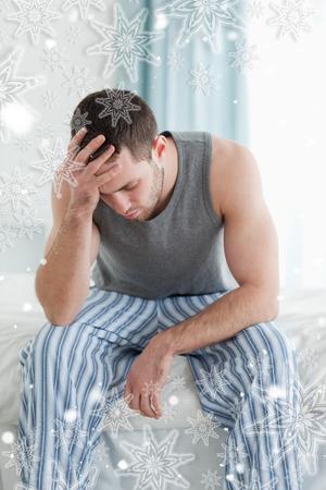 boring frame: Portrait of a sad man sitting against snowflakes