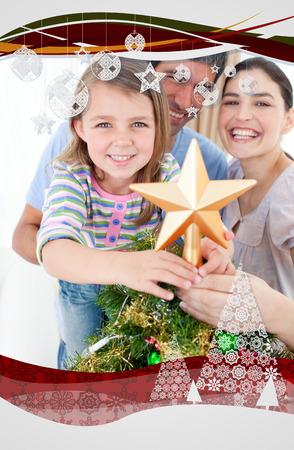 Composite image of family Christmas portrait against christmas frame photo