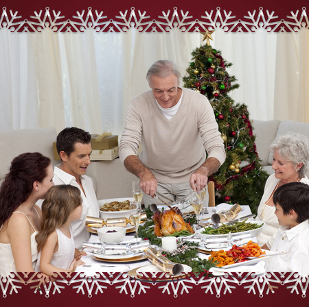 Family having Christmas dinner eating turkey against snowflake frame photo