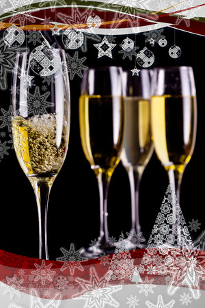 stemware: Christmas frame showing full glasses of champagne and one being filled