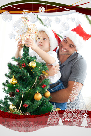 Father and son decorating their christmas tree with christmas frame photo