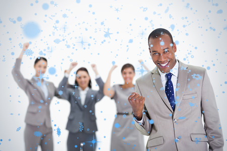 Successful business team with a man in the foreground against snow falling photo