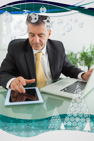 Business man working on digital tablet against christmas frame photo