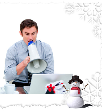 Angry businessman yelling through a megaphone  against christmas themed frame photo