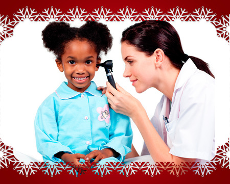 Female doctor checking her patients ears  against snowflake frame photo