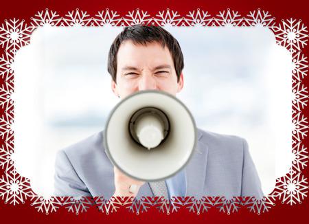 businessman using a megaphone: Portrait of an stressed businessman using a megaphone against snowflake frame
