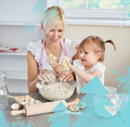 Simper woman baking cookies with her daughter against christmas frame photo