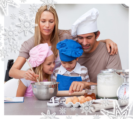 Children baking cookies with their parents against snowflakes photo