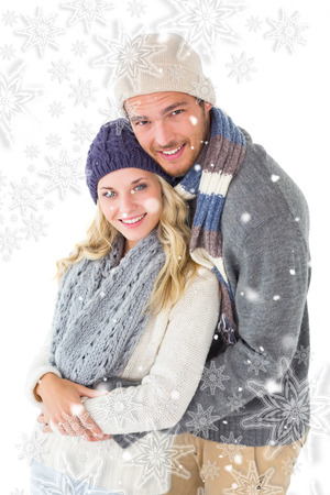 fashionable couple: Attractive couple in winter fashion hugging against snowflakes Stock Photo