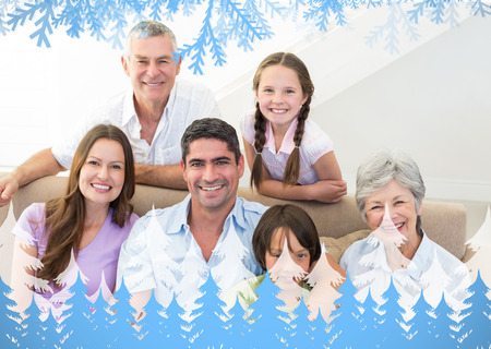 Composite image of smiling multigeneration family against frost and fir trees photo