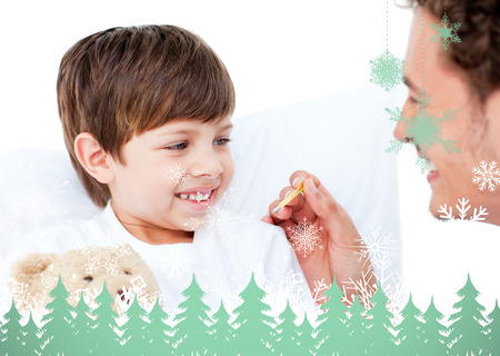 Handsome doctor taking little boys temperature against snowflakes and fir trees in green photo