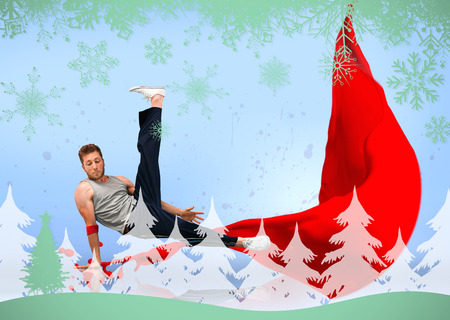skillfully: Break dancer skillfully balancing on one hand against snowflakes and fir tree in green