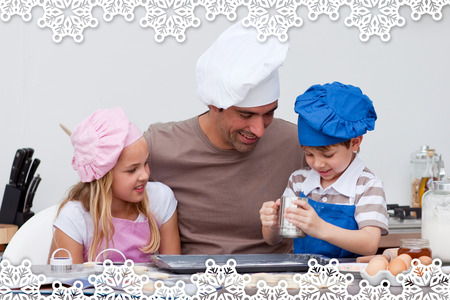 Father and children baking in the kitchen against snowflake frame photo