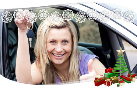 Charming female driver showing a key after bying a new car  against snowflake frame photo