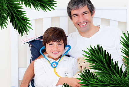 Cheerful father and his sick son playing with a stethoscope against digitally generated fir tree branches photo