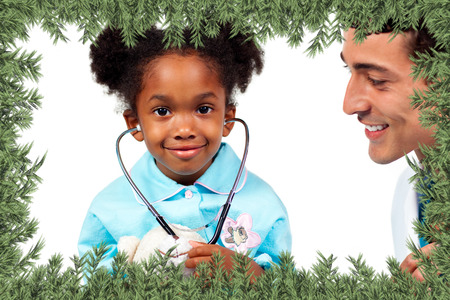 Attentive doctor playing with his patient  against green fir branches photo
