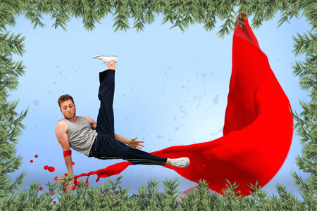 skillfully: Break dancer skillfully balancing on one hand against green fir branches