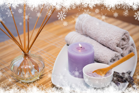 Fir tree forest and snowflakes against spa objects on wooden table photo